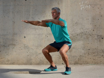 Elderly man practicing sports on the street